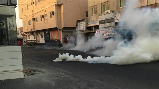 Smoke billows from teargas canisters fired by Bahraini police against protesters in the capital, Manama, September 30, 2016
