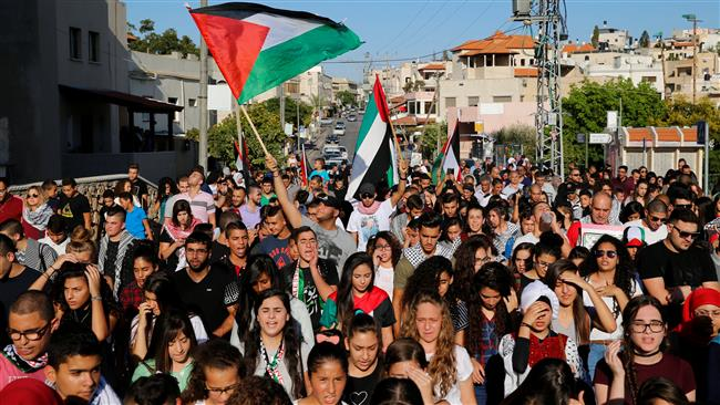 Palestinians living in the occupied territories march in Sakhnin on October 1, 2016, marking the 16th anniversary of the Second Palestinian Intifada. (Photo by Reuters)