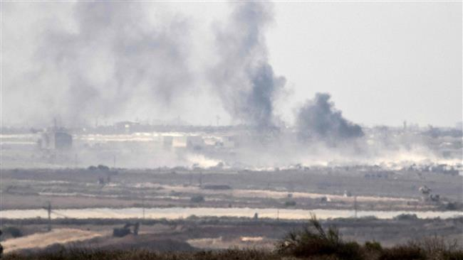 The picture shows smoke rising from the besieged Gaza Strip after an Israeli military strike on the coastal sliver on October 5, 2016. (Photos by AFP)