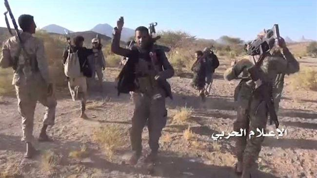 This photo, provided by the media bureau of the operations command in Yemen, shows Yemeni army soldiers and fighters from allied Popular Committees in an area in Sirwah district of Yemen's central province of Ma