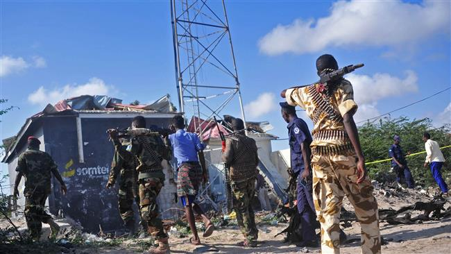 Members of the Somali military walk at the site of a car bomb attack near Mogadishu, September 18, 2016. (Photo by AFP)