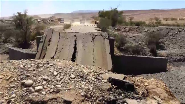 This photo shows a destroyed bridge following a Saudi airstrike in the Harf Sufyan district of the Yemeni northern province of Amran on October 20, 2016. (Photo by al-Masirah TV network)