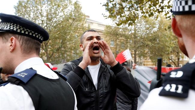 A protester shouts slogans during a demonstration against the visit of Bahrain
