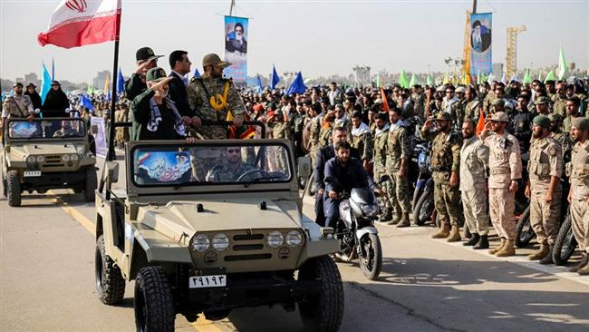 IRGC second-in-command Hossein Salami (1st L) salutes as his car passes by a group of armed forces in this file photo.