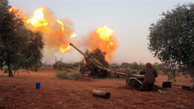 Militants fire shells towards Syria government positions on July 31, 2016.