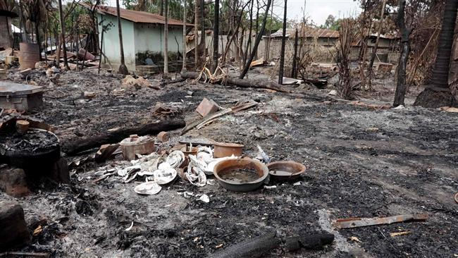 This photo shows the burned remains of a house in the Muslim Myo Thu Gyi Village, near the town of Maungdaw, in northern Rakhine State, Myanmar, on August 31, 2017. (Photo by AFP)