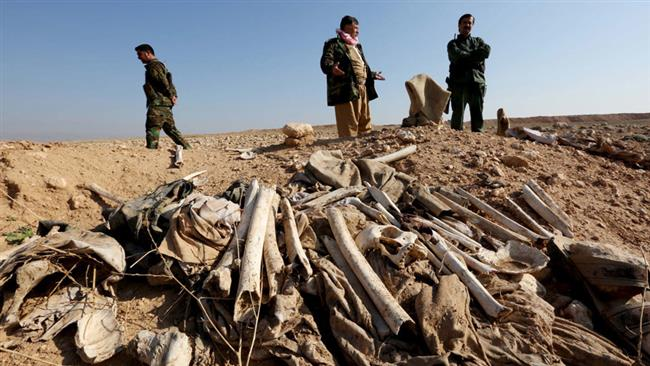 In this file photo, bones, suspected to belong to members of Iraq