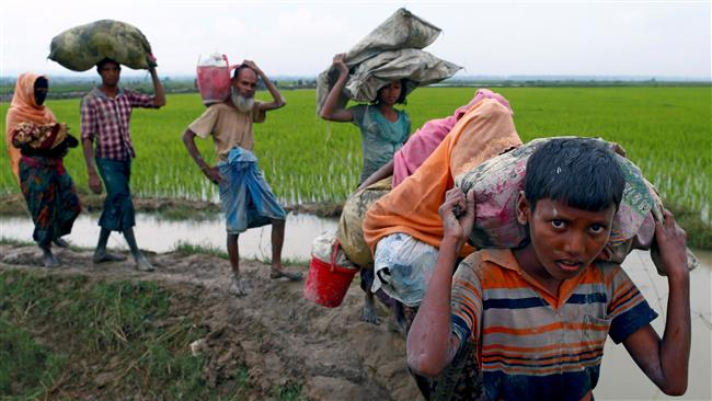 Rohingya Muslim refugees walk on a muddy path after crossing the Bangladesh-Myanmar border in Teknaf, Bangladesh, September 6, 2017. (Photo by Reuters)