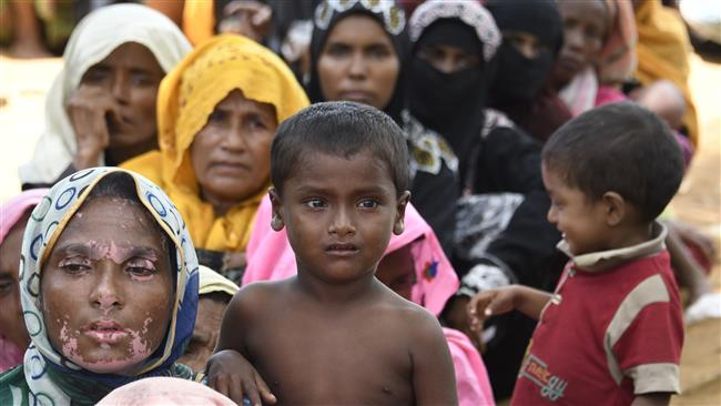 Rohingya refugees await registration at a government office in the Bangladeshi town of Ukhia on September 15, 2017. (Photo by AFP)