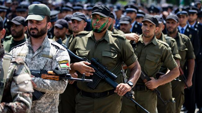 Hamas security forces take part in a military parade in Gaza City on July 26, 2017. (Photo by AFP)