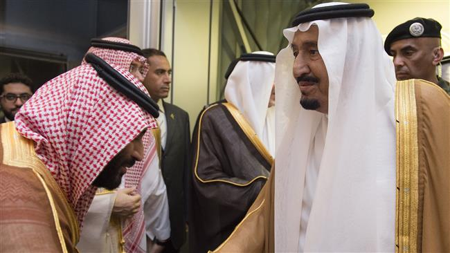 A handout picture provided by the Saudi Royal Palace on August 23, 2017 shows Saudi King Salman (R) being welcomed by his son Deputy Crown Prince and Defence Minister Mohammed bin Salman (L) at Jeddah airport upon his return from holiday in Morocco. (Photo by AFP)