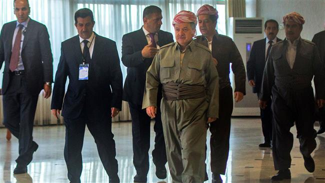 Iraqi Kurdish leader Massud Barzani (C-R) arrives to cast his vote in the Kurdish independence referendum at a polling station near Arbil, the capital of the autonomous Kurdish region of northern Iraq, on September 25, 2017. (Photo by AFP)