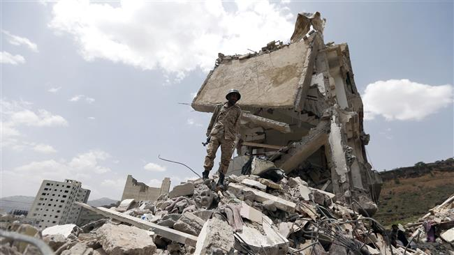 A Yemeni soldier stands on the debris of a house destroyed by a Saudi airstrike in the capital Sana'a on August 26, 2017. (Photo by AFP)