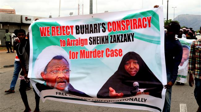 Supporters march with a banner to press for the release of Nigerian Shia Muslim cleric Ibrahim Zakzaky and his wife in the capital Abuja, Nigeria, May 14, 2018. (Photo by AFP)