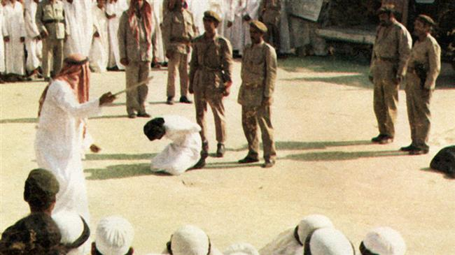 This file picture shows a man kneeling before being beheaded in Saudi Arabia.