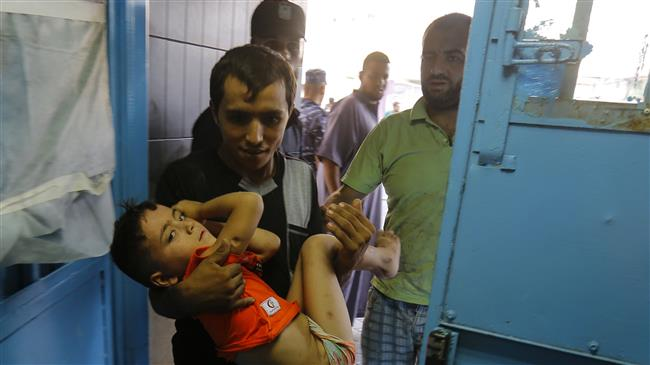 A wounded Palestinian boy is brought into al-Shifa hospital on August 9, 2018, following an Israeli airstrike on Gaza City. (Photo by AFP)