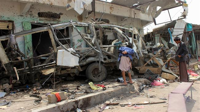 Yemenis gather next to a destroyed bus at the site of a Saudi-led airstrike that targeted the Dhahyan market the previous day in Sa'ada province, Yemen, on August 10, 2018. (Photo by AFP)
