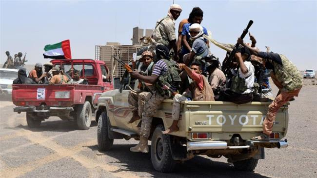The file photo shows Saudi-backed militants carrying UAE flag aboard a vehicle in Yemen.